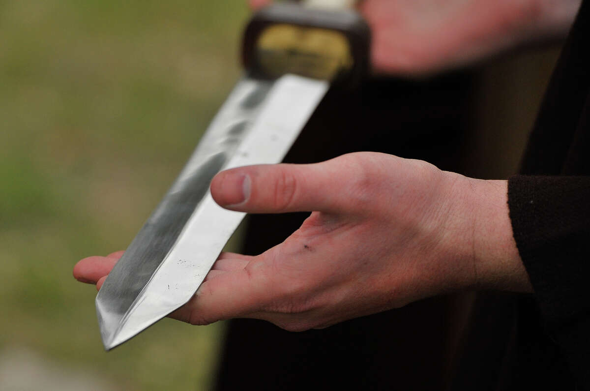 Charles Benson shows of what the sword blade of a Roman soldier may have looked like.