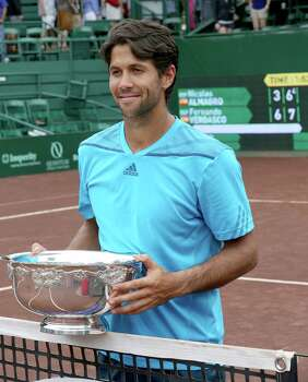 Fernando Verdasco (ESP) hold the trophy over his head after defeating Nicolas Almagro (ESP) ) 6-3, 76 in the singles finals on April 13, 2014 at the U.S. Men's Clay Court Championship at River Oaks in Houston, TX. . Photo: Thomas B. Shea, For The Chronicle / © 2014 Thomas B. Shea