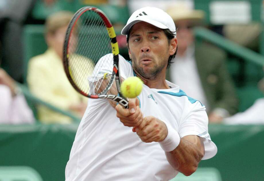 Fernando Verdasco (ESP) returns a shot against Nicolas Almagro (ESP) .Verdasco defeated Almagro 6-3, 76 in the singles finals on April 13, 2014 at the U.S. Men's Clay Court Championship at River Oaks in Houston, TX. . Photo: Thomas B. Shea, For The Chronicle / © 2014 Thomas B. Shea