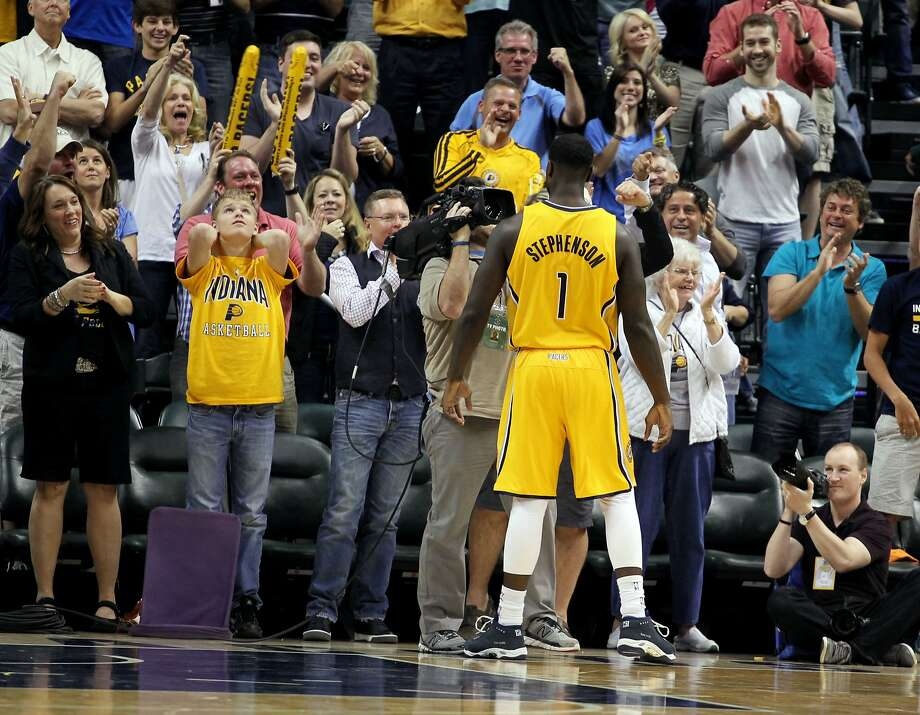Guard Lance Stephenson plays to the Indianapolis crowd on his way to a triple double and a win over the Thunder. Photo: Brian Spurlock, Reuters
