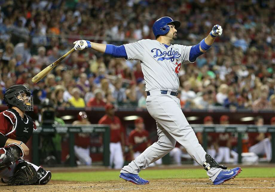 Dodgers first baseman Adrian Gonzalez smashes a three-run home run off the Diamondbacks' Trevor Cahill in the fourth inning. Photo: Christian Petersen, Getty Images