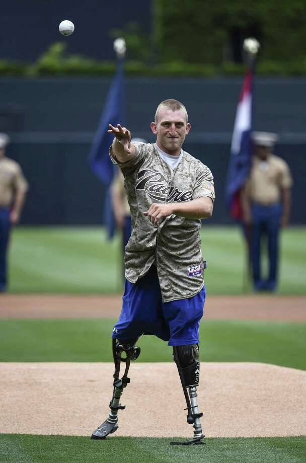SAN DIEGO, CA - APRIL 13:  U.S. Marine Corps veteran Rob Jones throws out the first pitch as part of Military Opening Day before an inter-league baseball game between the Detroit Tigers and the San Diego Padres at Petco Park April 13, 2014 in San Diego, California. Photo: Denis Poroy, Getty Images / 2014 Getty Images
