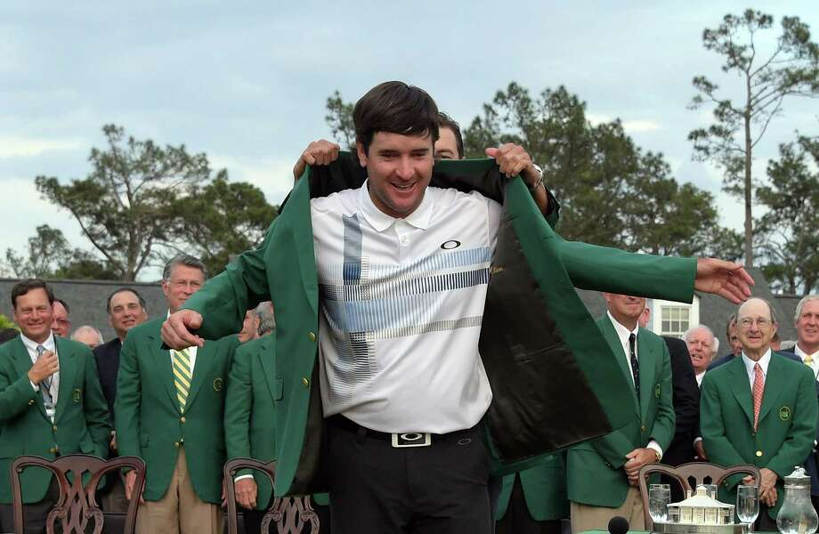 Adam Scott of Australia presents Bubba Watson of the US a Green Jacket during a ceremony at the end of the 78th Masters Golf Tournament at Augusta National Golf Club on April 13, 2014 in Augusta, Georgia. Watson won his second Masters finishing 8-under par. AFP PHOTO/Jim WATSONJIM WATSON/AFP/Getty Images Photo: JIM WATSON, AFP/Getty Images / AFP