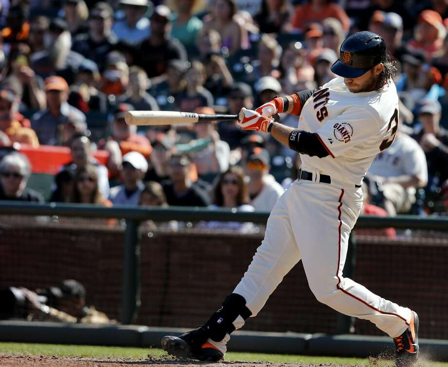 Brandon Crawford slugged a game winning home run in the bottom of the tenth inning to win the game. The San Francisco Giants defeated the Colorado Rockies 5-4 in ten innings Sunday April 13, 2014 at AT&T park. Photo: Brant Ward, The Chronicle