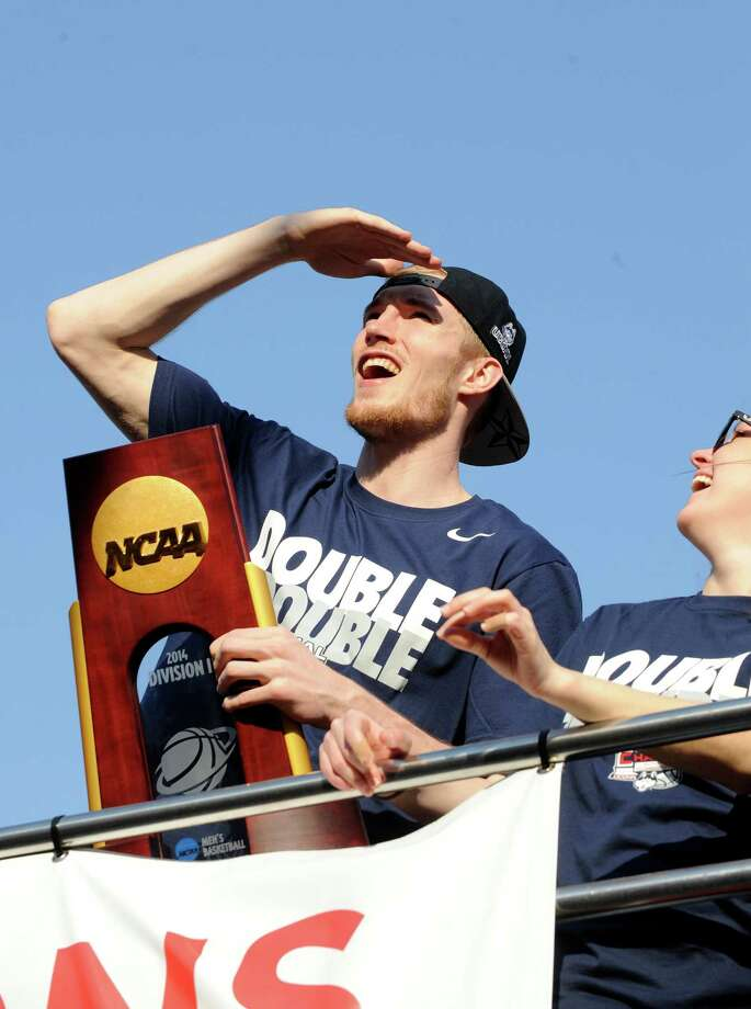 Connecticut's Niels Giffey watches the fans during a parade in Hartford, Conn., on Sunday, April 13, 2014, celebrating his team's  recent NCAA national basketball championship. Photo: Fred Beckham, AP / Associated Press