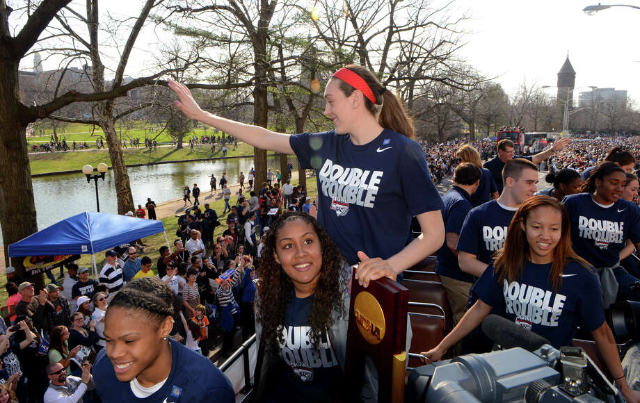UConn's Breanna Stewart waves to the crowds as she and the rest of the women's team rides in an open air bus through the streets in a UConn Victory Parade  and Rally held for them and the men's team in downtown Hartford, Conn. on Sunday April 13, 2014. Photo: Christian Abraham / Connecticut Post