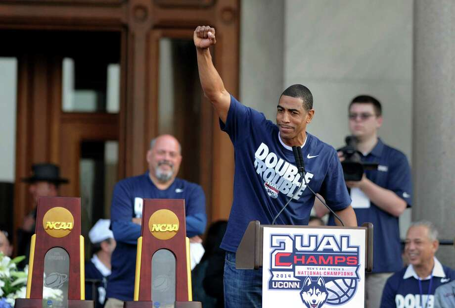 Connecticut men's basketball coach Kevin Ollie gestures during a celebration of UConn's championships in the NCAA men's and women's tournaments, at a rally at the State Capitol in Hartford, Conn., on Sunday, April 13, 2014. Photo: Fred Beckham, AP / Associated Press