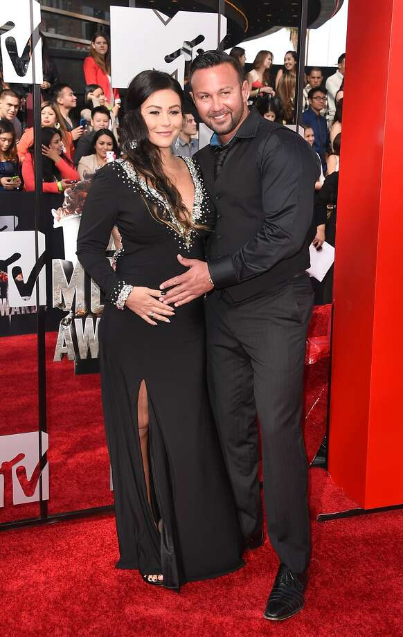 TV personality Jenni 'JWoww' Farley (L) and Roger Mathews attend the 2014 MTV Movie Awards at Nokia Theatre L.A. Live on April 13, 2014 in Los Angeles, California.  (Photo by Jason Merritt/Getty Images for MTV) Photo: Jason Merritt, Getty Images For MTV