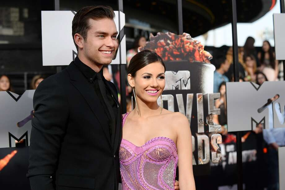 Pierson Fode, left, and Victoria Justice arrive at the MTV Movie Awards on Sunday, April 13, 2014, at Nokia Theatre in Los Angeles. (Photo by Jordan Strauss/Invision/AP) Photo: Jordan Strauss, Associated Press