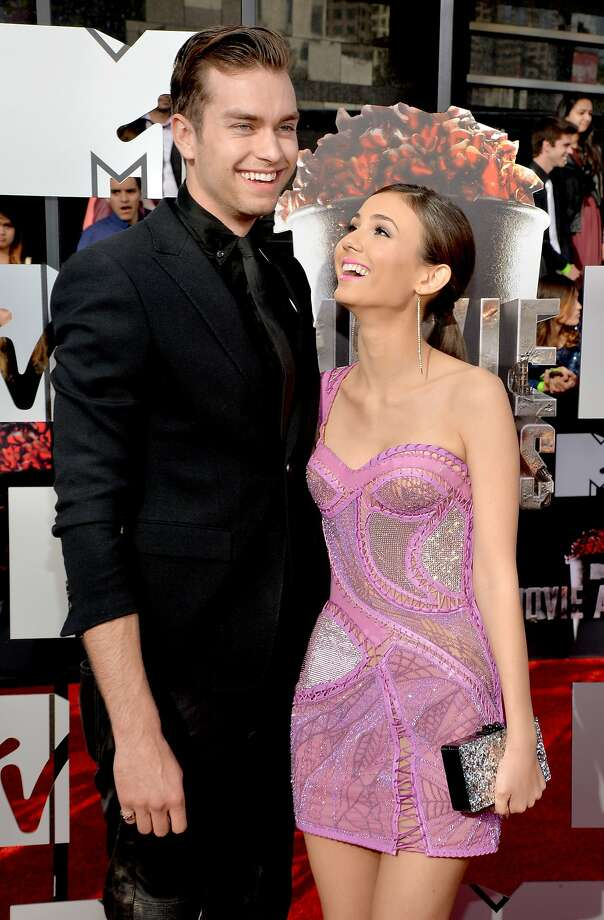 Actors Pierson Fode (L) and Victoria Justice attend the 2014 MTV Movie Awards at Nokia Theatre L.A. Live on April 13, 2014 in Los Angeles, California.  (Photo by Michael Buckner/Getty Images) Photo: Michael Buckner, Getty Images
