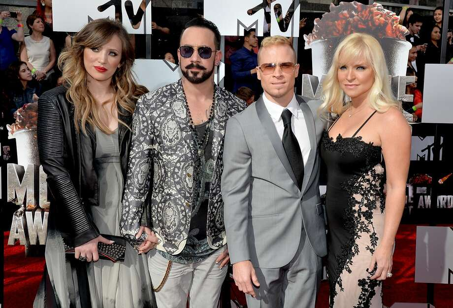 (L-R) Rochelle Deanna Karidis, singers AJ McLean and Brian Littrell of Backstreet Boys, and Leighanne Littrell attend the 2014 MTV Movie Awards at Nokia Theatre L.A. Live on April 13, 2014 in Los Angeles, California.  (Photo by Michael Buckner/Getty Images) Photo: Michael Buckner, Getty Images