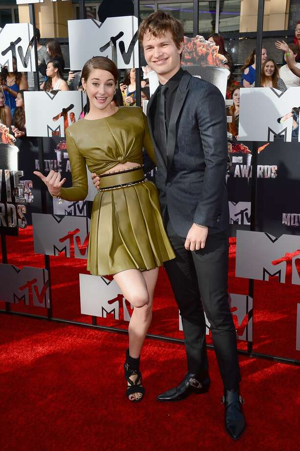Shailene Woodley, left, and Ansel Elgort arrive at the MTV Movie Awards on Sunday, April 13, 2014, at Nokia Theatre in Los Angeles. (Photo by Jordan Strauss/Invision/AP) Photo: Jordan Strauss, Associated Press