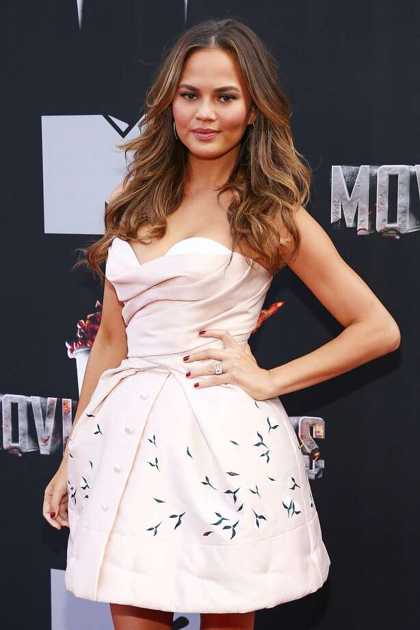 Model Chrissy Teigen attends the 2014 MTV Movie Awards at Nokia Theatre L.A. Live on April 13, 2014 in Los Angeles, California.  (Photo by Rich Polk/Getty Images for MTV) Photo: Rich Polk, Getty Images For MTV