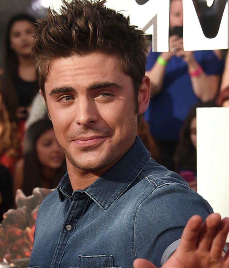 Actor Zac Efron attends the 2014 MTV Movie Awards at Nokia Theatre L.A. Live on April 13, 2014 in Los Angeles, California.  (Photo by Jason Merritt/Getty Images for MTV) Photo: Jason Merritt / Getty Images For MTV / 2014 Getty Images