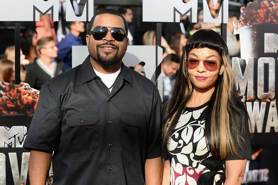 Ice Cube, left, and Kimberly Woodruff arrive at the MTV Movie Awards on Sunday, April 13, 2014, at Nokia Theatre in Los Angeles. (Photo by Jordan Strauss/Invision/AP) Photo: Jordan Strauss, Associated Press