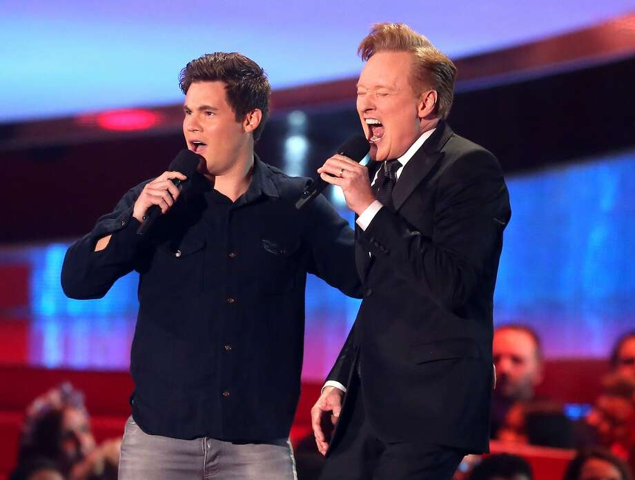 Actor Adam DeVine (L) and host Conan O'Brien perform onstage at the 2014 MTV Movie Awards at Nokia Theatre L.A. Live on April 13, 2014 in Los Angeles, California.  Photo: Frederick M. Brown, Getty Images