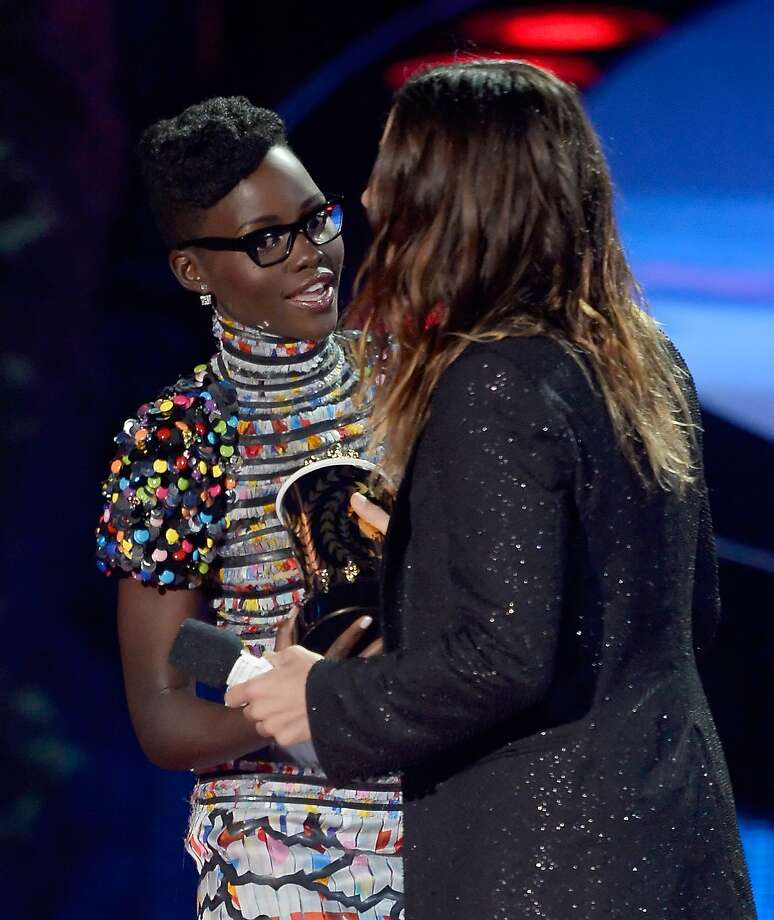 Actress Lupita Nyong'o (L) presents the Best Transformation Award to actor Jared Leto for 'Dallas Buyers Club' onstage at the 2014 MTV Movie Awards at Nokia Theatre L.A. Live on April 13, 2014 in Los Angeles, California.  Photo: Kevork Djansezian, Getty Images For MTV