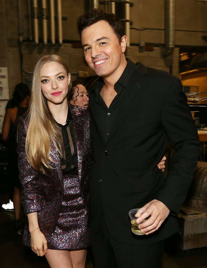 Actress Amanda Seyfried (L) and producer/writer Seth MacFarlane attend the 2014 MTV Movie Awards at Nokia Theatre L.A. Live on April 13, 2014 in Los Angeles, California. Photo: Christopher Polk, Getty Images
