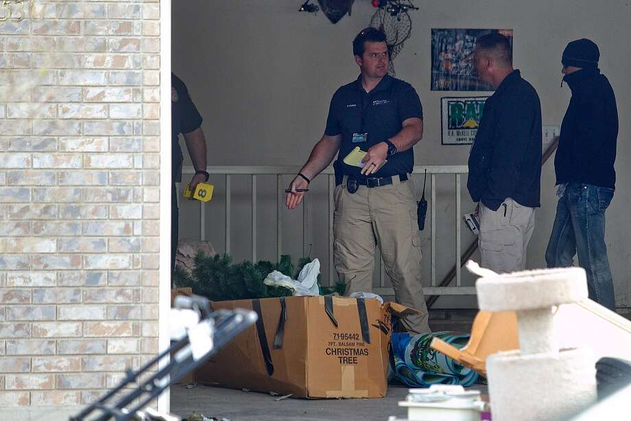 Authorities investigate the garage where seven dead infants were found stored in boxes in the former home of Megan Huntsman in Pleasant Grove, Utah. Photo: Mark Johnston, Associated Press