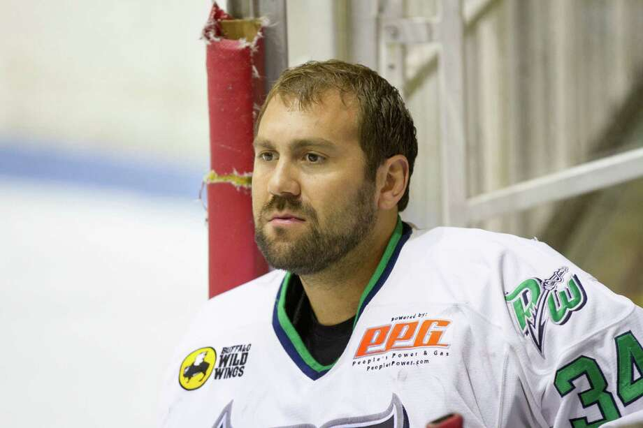 Injured Mike Brown (34) watches from the bench in Game Four of the FHL Commissioner's Cup championship series at Hara Arena in Dayton on April 13, 2014. Photo: Bill Thebert / The News-Times Freelance