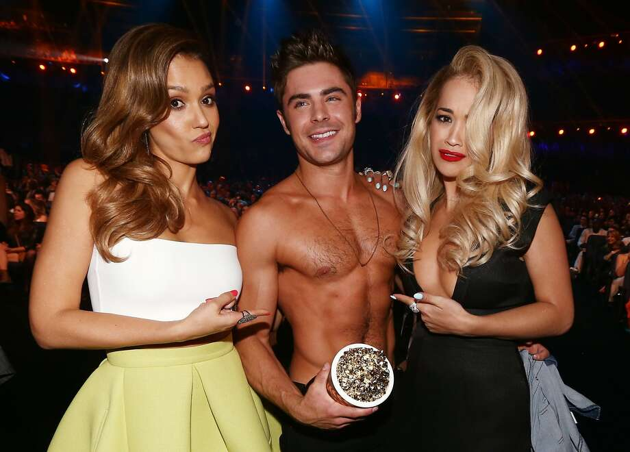 (L-R) Actress Jessica Alba, actor Zac Efron (holding the Best Shirtless Performance award for 'That Awkward Moment') and recording artist Rita Ora attend the 2014 MTV Movie Awards at Nokia Theatre L.A. Live on April 13, 2014 in Los Angeles, California. Photo: Christopher Polk, Getty Images
