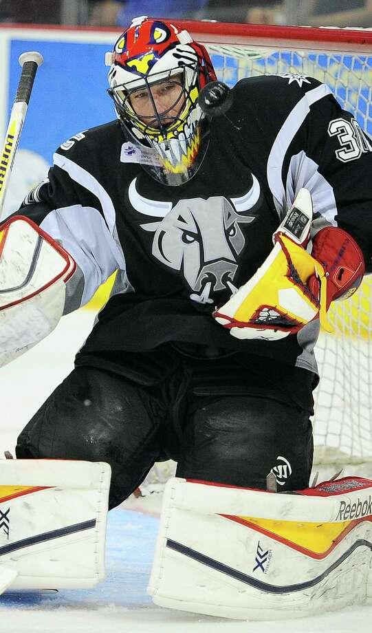 Rampage goaltender Scott Clemmensen makes a save during the overtime period against the Texas Stars. He had 40 saves in the game. Photo: Darren Abate / For The Express-News / Darren Abate/DA Media, LLC