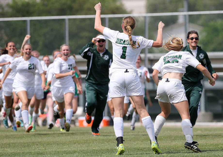 Reagan's Taryn Sherman (1) and her teammates celebrate after her penalty kick helped beat Churchill 1-0 in the Region IV-5A final at Blossom Stadium. Reagan is back in the state tourney for the first time since 2009. Photo: Marvin Pfeiffer / Express-News / Express-News 2014