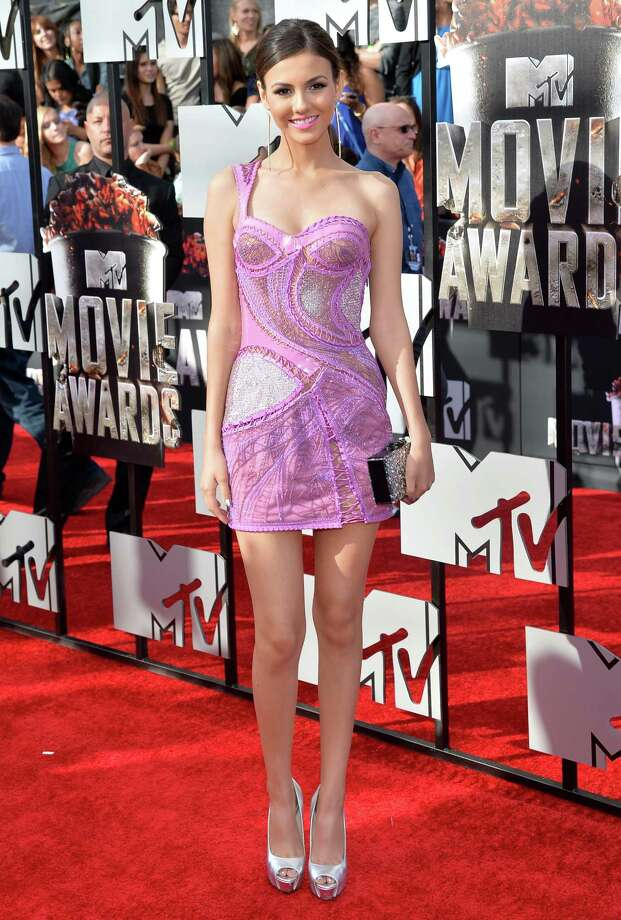 Actress Victoria Justice attends the 2014 MTV Movie Awards at Nokia Theatre L.A. Live on April 13, 2014 in Los Angeles, Calif. Photo: Michael Buckner, Getty Images / 2014 Getty Images