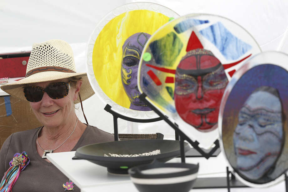 Virginia Bally, of Bally Studios Ceramics, sells her art work during the Deco District Arts & Musical Festival sponsored by the Network for Young Artists in the 1800 block of Fredericksburg Road. Photo: Jerry Lara / San Antonio Express-News / ©2014 San Antonio Express-News