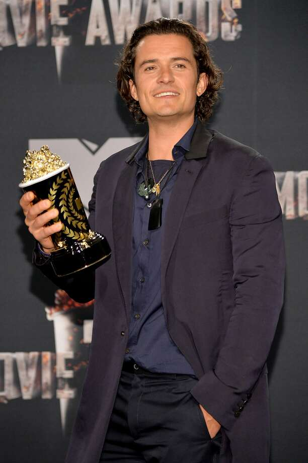 Actor Orlando Bloom poses with the  Best Fight award in the press room during the 2014 MTV Movie Awards at Nokia Theatre L.A. Live on April 13, 2014 in Los Angeles, California.  Photo: Michael Buckner, Getty Images