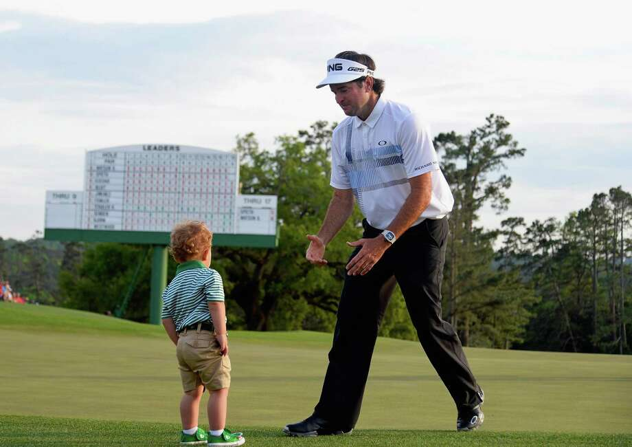 AUGUSTA, GA - APRIL 13:  Bubba Watson of the United States walks towards his son Caleb on the 18th green after winning the 2014 Masters Tournament by a three-stroke margin at Augusta National Golf Club on April 13, 2014 in Augusta, Georgia.  (Photo by Harry How/Getty Images) ORG XMIT: 461742841 Photo: Harry How / 2014 Getty Images