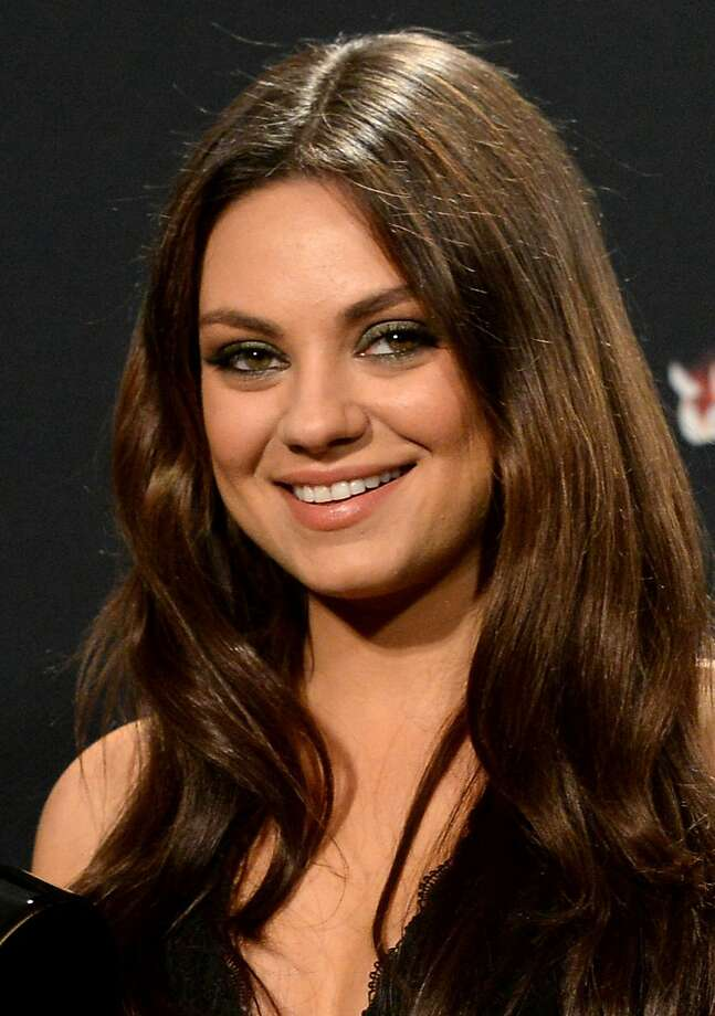Actress Mila Kunis poses in the press room during the 2014 MTV Movie Awards at Nokia Theatre L.A. Live on April 13, 2014 in Los Angeles, California.  Photo: Jason Merritt, Getty Images For MTV