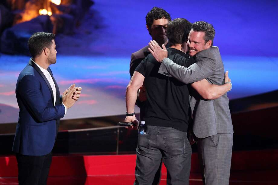 From left, Jerry Ferrara, Adrian Grenier and Kevin Dillon present the generation award to Mark Wahlberg, center, on stage at the MTV Movie Awards on Sunday, April 13, 2014, at Nokia Theatre in Los Angeles. Photo: Matt Sayles, Associated Press