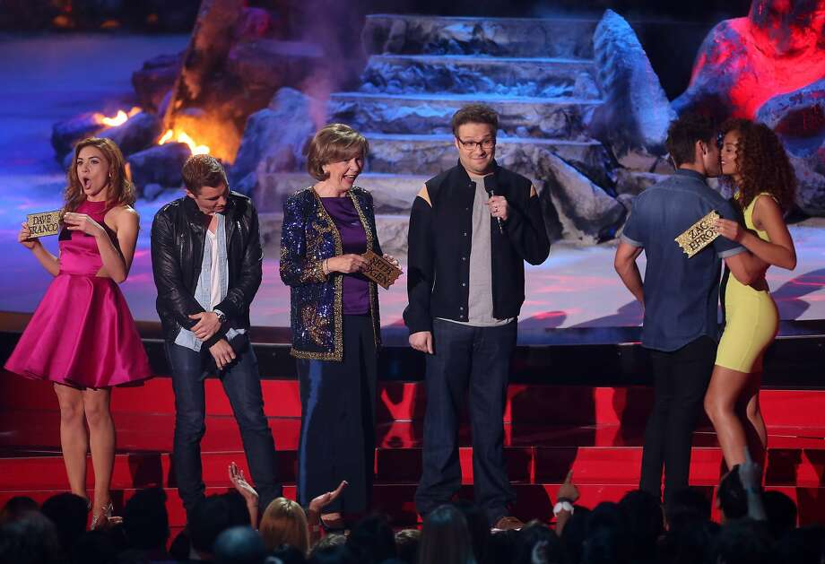 (L-R) Actors Peyton McCormick, Dave Franco, Sandra Daubert, Seth Rogen, Zac Efron and Tiffany Luce speak onstage at the 2014 MTV Movie Awards at Nokia Theatre L.A. Live on April 13, 2014 in Los Angeles. Photo: Frederick M. Brown, Getty Images