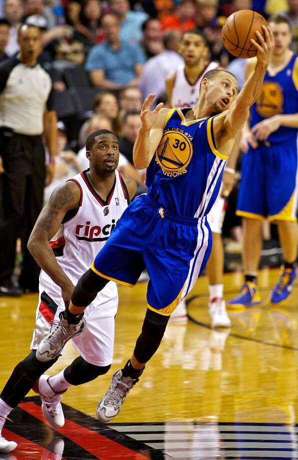 Stephen Curry reaches for the ball to avert a backcourt violation in front of Portland's Wesley Matthews in the third quarter at the Moda Center. Curry's 47 points, which included seven three- pointers, were a season high. He also had five assists and three steals. Photo: Craig Mitchelldyer, Reuters