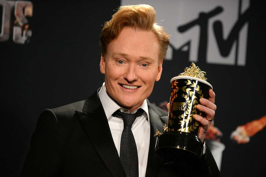 Conan O'Brien poses in the press room at the MTV Movie Awards on Sunday, April 13, 2014, at Nokia Theatre in Los Angeles. Photo: Jordan Strauss, Associated Press