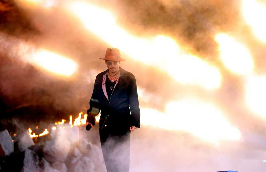 Actor Johnny Depp speaks onstage at the 2014 MTV Movie Awards at Nokia Theatre L.A. Live on April 13, 2014 in Los Angeles, California. Photo: Frederick M. Brown, Getty Images
