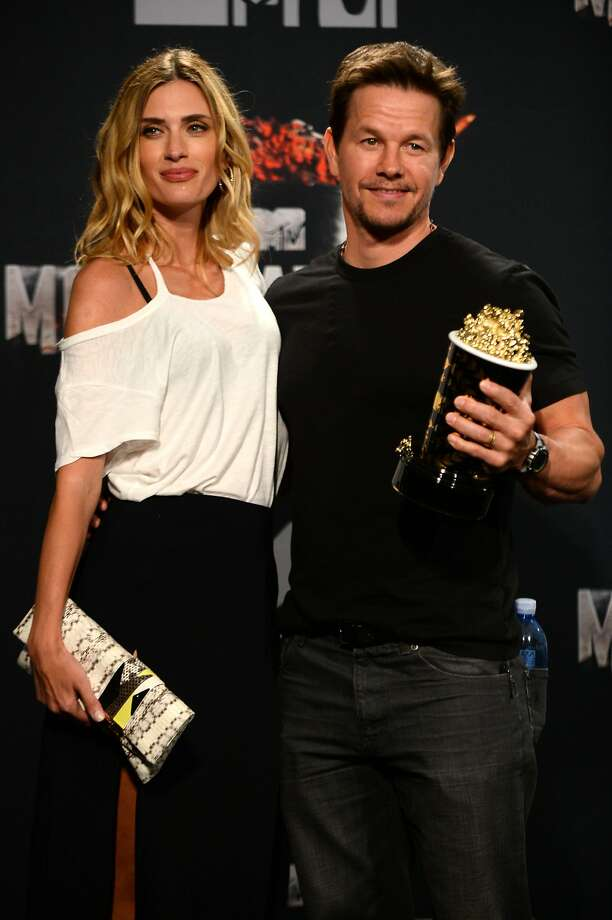 Mark Wahlberg, right, poses in the press room with his MTV Generation Award, and Rhea Durham, at the MTV Movie Awards on Sunday, April 13, 2014, at Nokia Theatre in Los Angeles.  Photo: Jordan Strauss, Associated Press