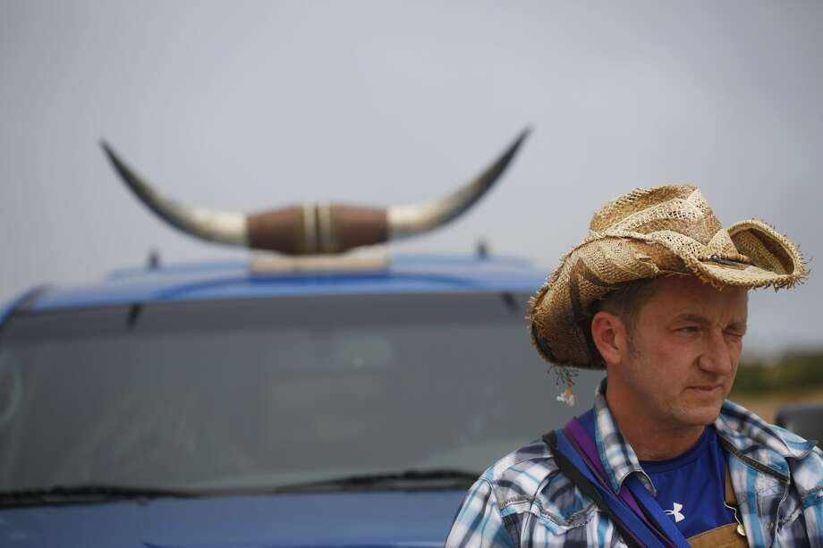 With signature steer horns on the top of his truck Wild Bill Peacock takes a break at the end of Fort Funston Walk. Photo: Mike Kepka, The Chronicle
