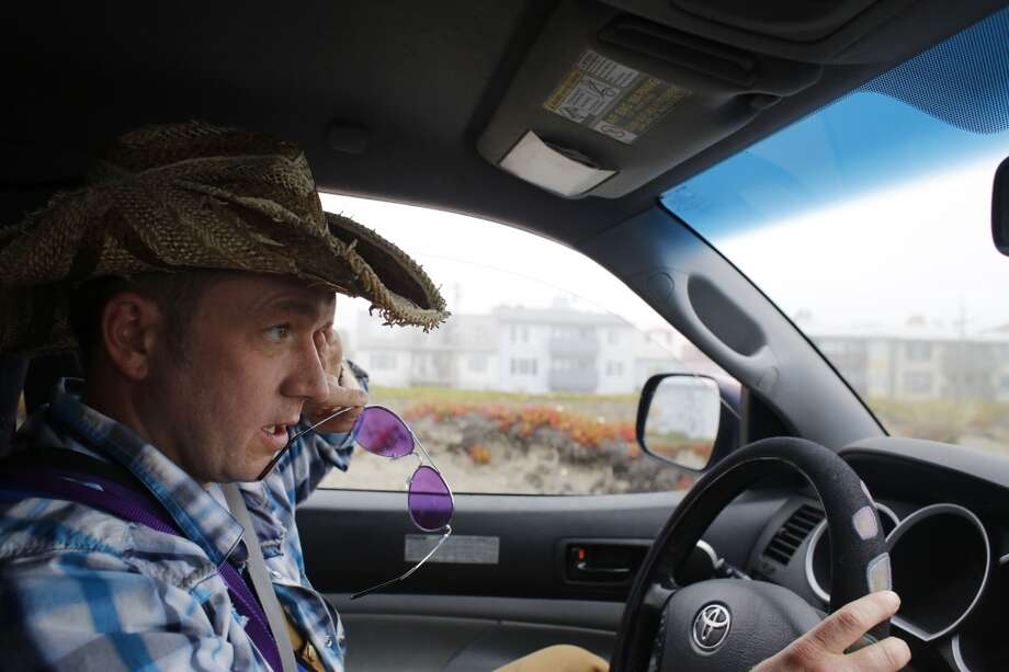 Wild Bill Peacock says driving is at least of the job of the professional dog walker in San Francisco. Photo: Mike Kepka, The Chronicle