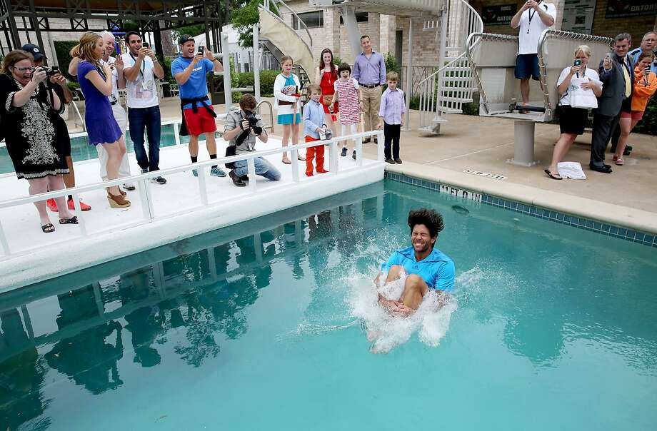 Fernando Verdasco, of Spain, jumps in the River Oaks Country Club's pool after defeating Nicolas Almagro, of Spain, 6-3, 7-6 (4) in the singles finals at the U.S. Men's Clay Court Championship tennis tournament on Sunday, April 13, 2014, in Houston, Texas. (AP Photo/Houston Chronicle, Thomas B. Shea) Photo: Thomas B. Shea, Associated Press