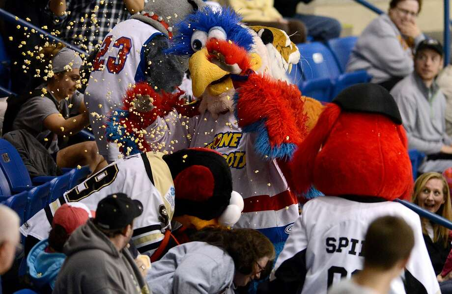 Mascots engage in a popcorn fight, Sunday, April 13, 2014, during the Wilkes-Barre/Scranton Penguins' AHL hockey game against the Toronto Marlies on Sunday, April 13, 2014, in Wilkes-Barre, Pa. (AP Photo/Citizens' Voice, Andrew Krech) MANDATORY CREDIT Photo: Andrew Krech, Associated Press