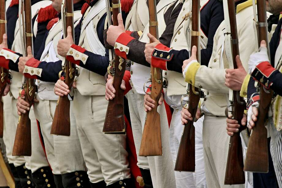 Enthusiasts dressed up as French soldiers swear loyalty to Napoleon Bonaparte after a re-enactment of a battle in Valtice, south Moravia, 50 km south from Brno, Czech Republic, on April 13, 2014. The year 2014 marks the 200th anniversary of the Napoleon's French campaign of 1814, battles at Montereau, Reims or Montmirail, and a number of other (205th anniversary of the Battle of Sacile, the 200th anniversary of the Battle of the Mincio), and the 209 anniversary of the Battle of Austerlitz.   AFP PHOTO/ RADEK MICARADEK MICA/AFP/Getty Images Photo: Radek Mica, AFP/Getty Images