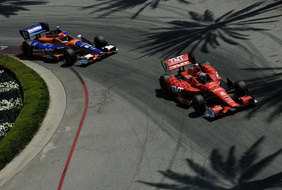 LONG BEACH, CA - APRIL 13: Ryan Briscoe of Australia driver of the #8 NTT Data Chip Ganassi Racing Dallara Chevrolet leads Charlie Kimball driver of the #83 Chip Ganassi Racing Teams Dallara Chevrolet during the Verizon IndyCar Series Toyota Grand Prix of Long Beach on April 13, 2014 on the streets of Long Beach, California. (Photo by Robert Laberge/Getty Images) Photo: Robert Laberge, Getty Images