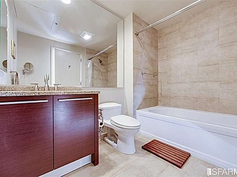 The condo's only bathroom has granite countertops. Photo:  MLS
