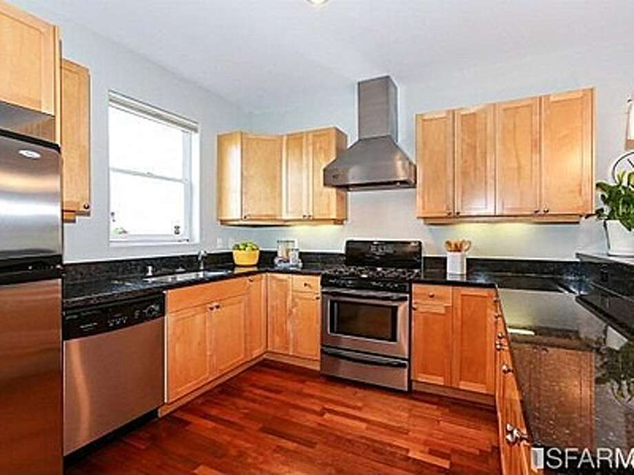 The spacious kitchen has stainless steel appliances and granite countertops. Photo: MLS