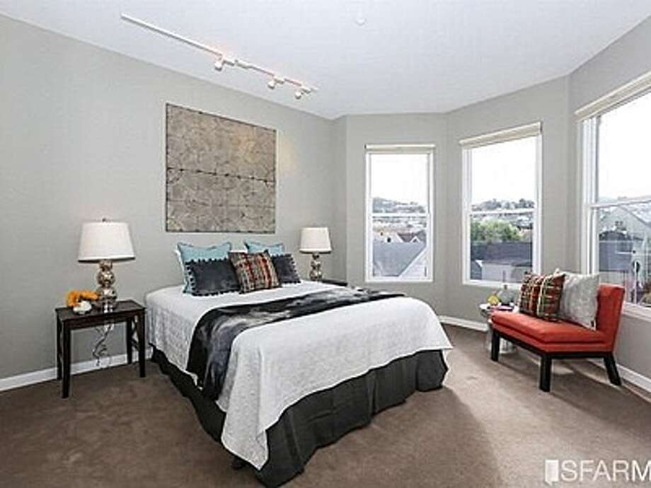 The master bedroom has gorgeous views out the bay windows. Photo: MLS