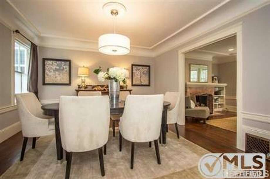 The formal dining room contains original molding and the original built-in hutch. Photo: MLS