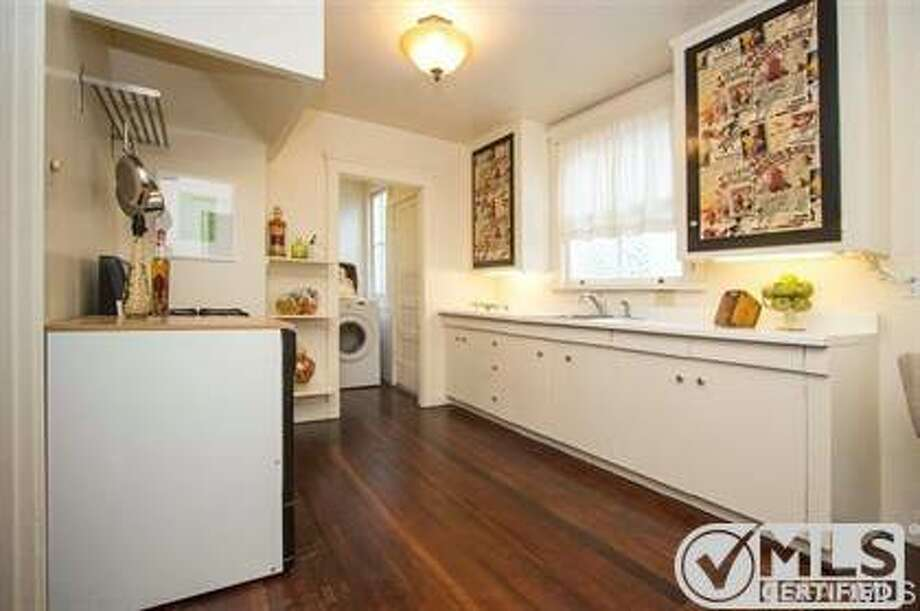 The galley-style kitchen leads to the laundry room. Photo: MLS