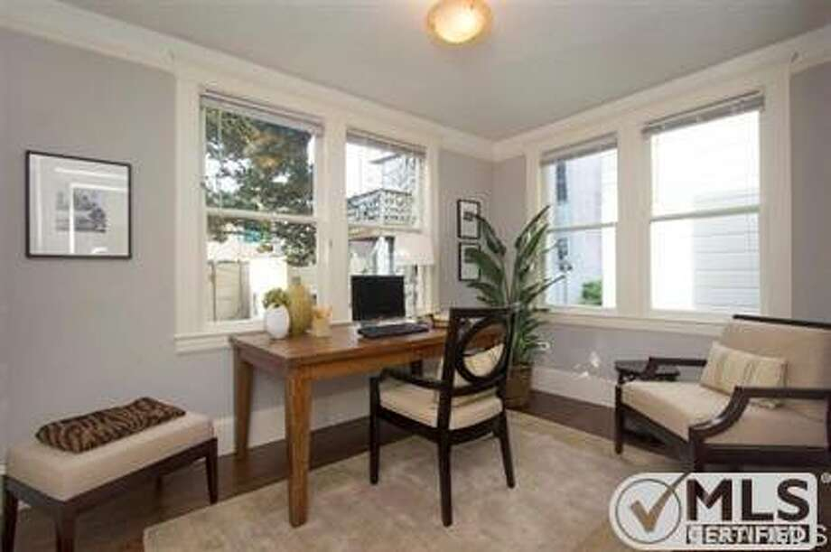 The office/sunroom looks out onto the shared backyard. Photo: MLS